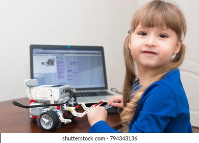December, 2017. Minsk, Belarus.  STEM education. Little girl programmes Lego Mindstorms EV 3 Robot on Scratch. Battle. Robotics class for child and teen. School.  Mathematics.