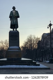 December 2018 - Moscow, Russia - winter landscape of Gogol boulevard of Moscow with Nikolay Gogol sculpture.