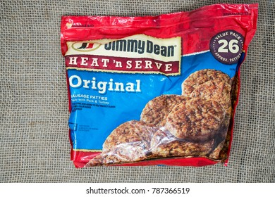 DECEMBER 22 2017 - NEW HOPE, MN: Package of Jimmy Dean Heat 'n Serve Pork Breakfast Sausage on a burlap background