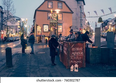 December 24, 2016, Reykjavik, Iceland. Panoramic view of the city. Main streets and street food stall at Christmas. Unidentified people stroll and do their Christmas shopping