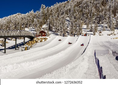 December 26, 2018 South Lake Tahoe / CA / USA - Tourists tubing on the slopes of Heavenly Ski Resort on a sunny winter day