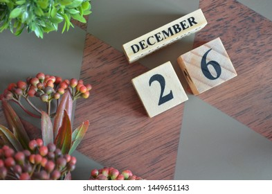 December 26. Date of December month. Diamond wood table for background.