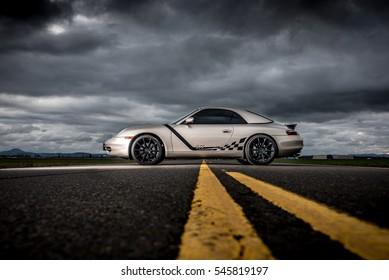December 28th,2016 Eugene Or Porsche 911 1999 Silver with black wheels dark gray clouds