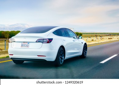December 3, 2018 Los Angeles / CA / USA - White Tesla Model 3 driving on the freeway