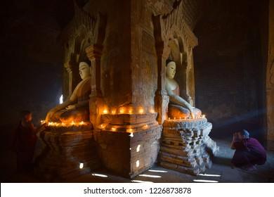 ฺBagan,Myanmar - December 30,2016 : Two Novice light candle and pray in bagan pagoda in Myanmar.