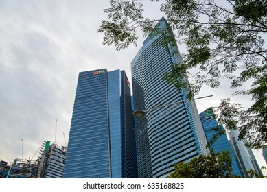 December 31, 2016. Wide angle view of the skyscrapers in the Mariana Bay Financial Center, with trees in the foreground and DBS Bank's Tower 3 in the background. Downtown Core, Singapore.