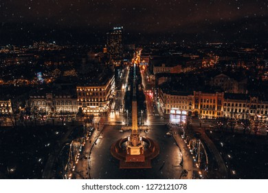 December 31, 2018. Riga, Latvia. Aerial night view of the Riga old town, opera house and the statue of liberty Milda.