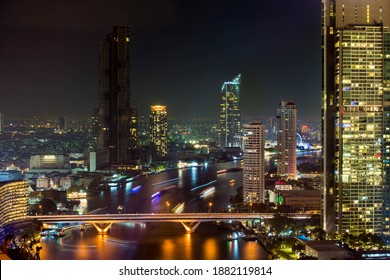 December 31, 2019 in BANGKOK, THAILAND: A lot of people on Taksin Bridge are waiting for Bangkok New Year Countdown Fireworks over Chao Phraya river at midnight, taken from CAT Telecom Tower