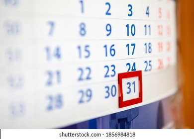 The December, 31, 2020, paper calendar with red frame for date, close-up view