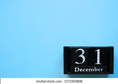 December 31, calendar, on a blue background. New year. Day 31 of december month. Copy space