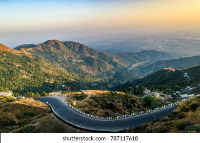 December 31,2016, Darjeeling, West Bengal,India. Hill top view at the time of Sunset with curvy hilly road.