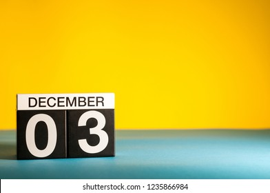 December 3rd. Image 3 day of december month, calendar on yellow background. Winter background with empty space for text, mockup