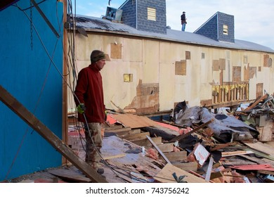December 5, 2012 -Seaside Heights, NJ, USA: A month after Superstorm Sandy, two of the many volunteers who are helping to restore the shore take a look out at the monumental task ahead of them.
