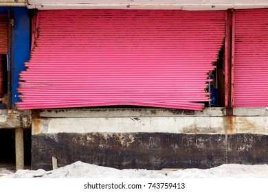 December 5, 2012 -Seaside Heights, NJ, USA: A month after Superstorm Sandy, battered steel security doors that were no match for the storm remain on what is left of the boardwalk shops.