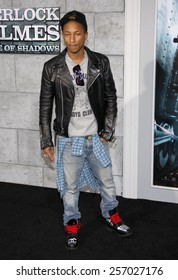 """December 6, 2011. Pharrell Williams at the Los Angeles premiere of """"Sherlock Holmes: A Game Of Shadows"""" held at the Regency Village Theatre, Los Angeles."""