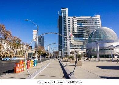 "December 6, 2017 San Jose / CA / USA - Downtown urban landscape; banners posted with the message ""We welcome everyone"" in various languages on the side of the road, Silicon Valley, San Francisco bay"