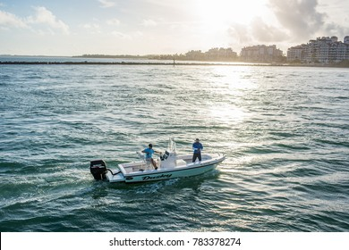 December 7, 2017: Miami Beach, Florida: A fisherman on a small boat in Miami Beach, Florida.   Fishing is a popular activity in Miami Beach.