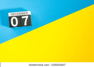 December 7th. Image 7 day of december month, calendar on blue-yellow background with empty space for text, mockup