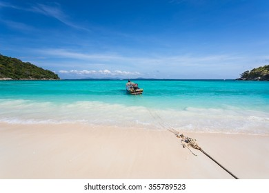 December 8, 2015 a longtail boat has anchored on the bay for safety during low tide on Racha island in Thailand