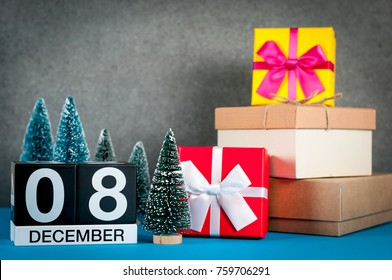 December 8th. Image 8 day of december month, calendar at christmas and new year background with gifts and little Christmas tree