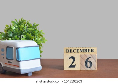December cover design with number cube and car, Date 26.