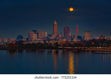 The December full moon high above downtown Cleveland, Ohio