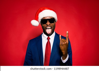 December merry noel job work worker winter eve event festive concept. Funky mood chic classy confident stylish trendy tux suit style man formalwear spectacles show rock sign isolated red background