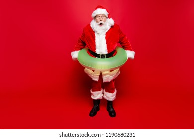 December noel eve sale discount pool party. Full legs body size aged mature grandfather funny Santa tradition costume headwear spectacles white beard isolated red background open mouth staring eyes