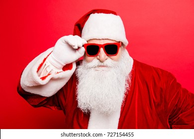 December surprise, travel, trips, party time! Holly jolly x mas noel! Cool funny playful naughty tourist santa grandfather, fooling around, holding his trendy specs, so confident