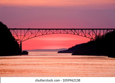 Deception Pass bridge between Fidalgo and Whidbey Islands and distant islands at twilight, Washington.