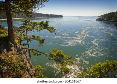 Deception Pass State Park, Washington .Rugged cliffs drop to meet the turbulent waters of Deception Pass. The park is known for its breath-taking views, old-growth forests, and abundant wildlife.