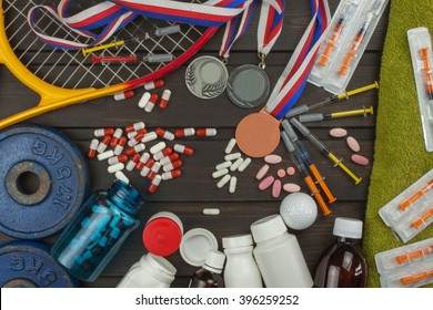 Deception in sports. Doping for athletes. Scammers in the sport. Abuse of anabolic steroids for sports. Anabolic steroids spilled on a wooden table. Fraud in sports.