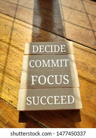 decide commit focus succeed written on wooden block