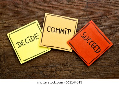 Decide, commit, succeed motivational word abstract on colorful sticky notes against rustic wood