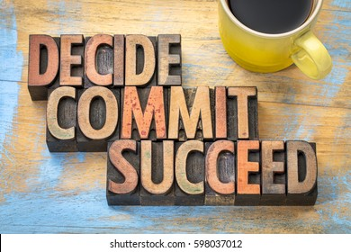 Decide, commit, succeed word abstract in vintage letterpress wood type with a cup of coffee