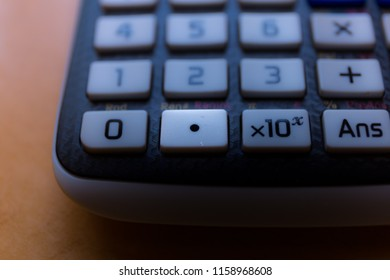 Decimal point key of a scientific calculator