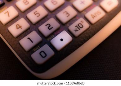Decimal point key of a scientific calculator
