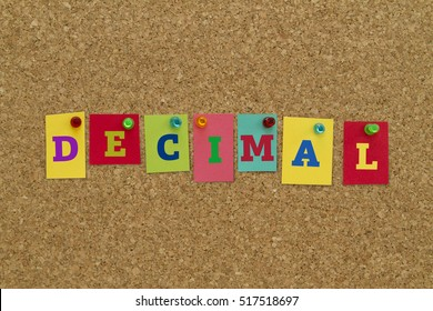 Decimal word written on colorful sticky notes pinned on cork board.