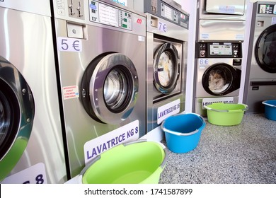 Decimomannu / Italy - May 17 2020: interior view of a laundromat