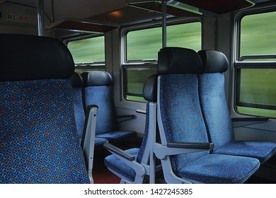 Decin, Czech republic - June 14, 2019: windows and chairs in passenger train leading from to Usti nad Labem city