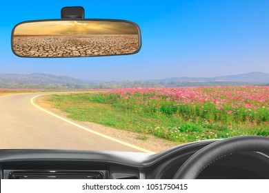 Decision change of life concept: In a car on the road in to beautiful nature and rear view mirror between climate worsened with good atmosphere