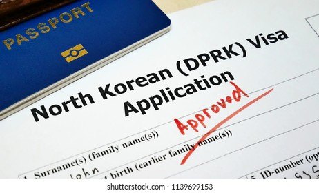 The decision to grant a North Korean a. Approved in Application form with passport and pen. Document with passport, apply and permission for foreigner country