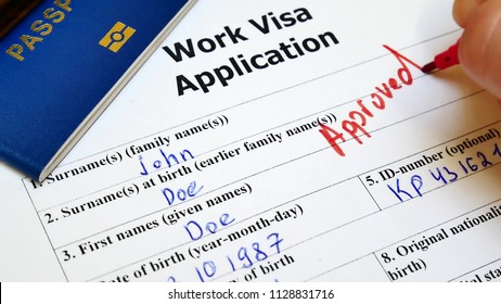 The decision to grant a visa. Pen voting approved in checkbox in blank Work Visa application form with passport and pen. Document with passport, apply and permission for foreigner country