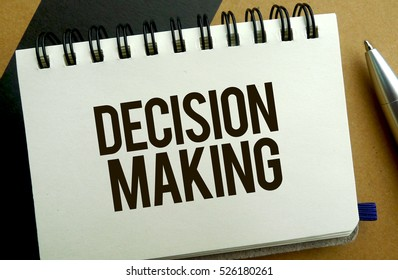 Decision making memo written on a notebook with pen