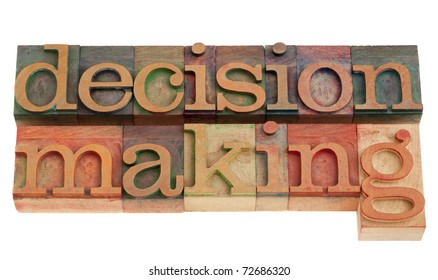 decision making phrase in vintage wood letterpress printing blocks, isolated on white