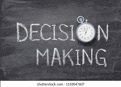 decision making phrase written on chalkboard with vintage stopwatch used instead of O