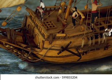 Deck of the Ancient, perhaps pirate, wooden Ship with a team that is busy with its own business