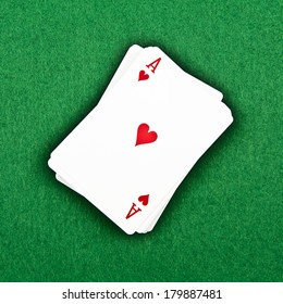 A deck of cards on a green background