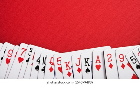 A deck of cards for playing poker on a red table in a casino
