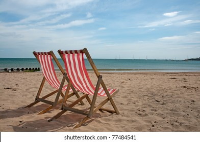 deck chair on beach in Swanage, England